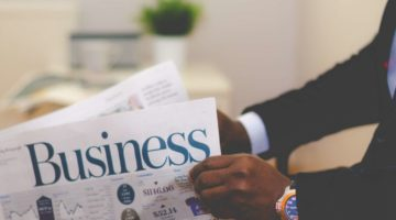 person-holding-white-and-blue-business-paper-936137 (1)